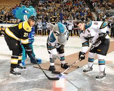 Worcester Sharks defenseman Dylan DeMelo and Providence Bruins forward Bobby Robins pose for the faceoff photo as FINZ drops the puck with SCRATCH looking on (Oct. 18, 2014).