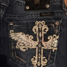 Miss me angel cross design Miss me, size 31, good condition, only wore a few times, a bit frayed cuffs but not noticeable, just too small Miss Me Jeans Boot Cut