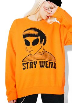 "Stay Weird Sweatshirt - Burger And Friends Stay Weird Sweatshirt ...cuz there's no other way to be, babe. This sweatshirt features a cozy orange construction and a too cool alien smokin' on tha front with black ""Stay Weird"" text underneath."
