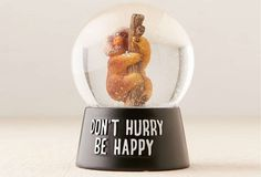 """Celebrating the laid-back sloth is this snow globe that says, appropriately enough, """"Don't Hurry, Be Happy."""""""