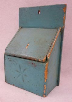 """Hyde Park Auctions - May 30, 2015. Lot 367. Estimate: $100 - $200. Realized: $ 270. Description: Old salt box in old robins egg blue paint. Carved snow flake on front panel. Late 19th century. 10""""H x 7""""W. Very good condition."""