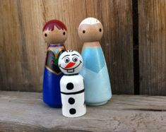 Frozen Olaf, Princess Anna, and Queen Elsa -  Pegbuddies Wood Peg Doll Peg People Birthday Cake Topper