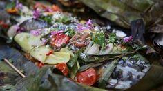 "Cheong Liew's grilled whole flathead in banana leaf is, ""in one word — incredible!"" says Maeve O'Meara. #seafoodsurprise #FoodSafari"