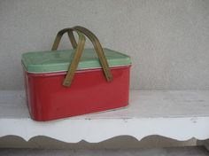 I bought this vintage metal picnic basket on etsy. It sits on the shelves in the downstairs bathroom and holds the flannel rice packs we use for hot packs.
