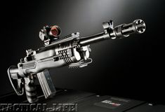 Customized Ruger Mini-14 with pistol grip stock, flash suppressor & M4 Aimpoint optic.