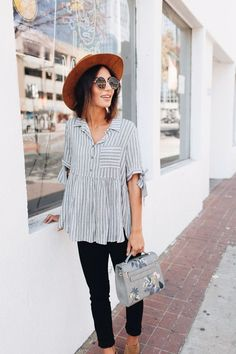 Love this striped top for spring! And the floral bag, round sunglasses, and wide brimmed hat!
