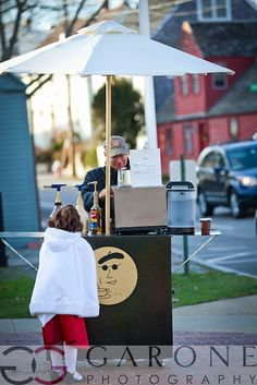 A hot cocoa and eggnog cart outside a winter wedding ceremony location to help guests warm up.