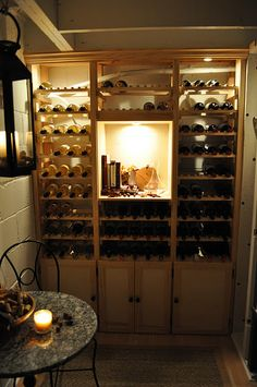 Such a cute little wine cellar!  I want one!