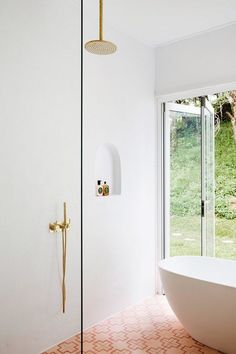 In lieu of traditional bathroom decor (like colorful bath mats or a thriving plant) we're encouraged to take a different approach, such as highlighting the architectural elements of a room. To help you get started we compiled a shortlist of the minimalist shower ideas you need on your radar. #hunkerhome #minimalist #showerideas #minimalistshowerideas #bathroom Modern Bathroom, Free Standing Bath, Bathroom Flooring, Bathroom Decor, Freestanding Bathroom Cabinet, Bathrooms Remodel, Three Birds Renovations, Bathroom Renovations, Bathroom Design