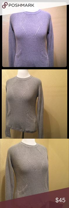 Lululemon women's knit sweater This really warm, soft knit Lululemon women's sweater is perfect for the season. It looks great on, has a stretchy feel, side pockets and a beautiful simple knit pattern giving it a more feminine look. It is a fitted style so it could medium or a large. lululemon athletica Sweaters Crew & Scoop Necks