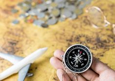 explorer is holding compass for direction in traveling the world