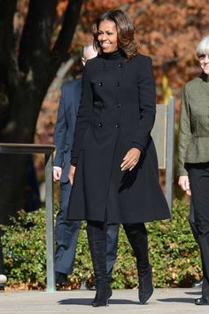 <p>During a ceremony to honor veterans at the Tomb of the Unknowns, she breaks out a double breasted black Burberry coat that's a complete classic.</p>