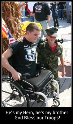Cpl Todd Love, lost both legs and half an arm in Afghanistan, with Young Marine Luke S.