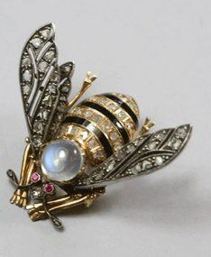 It is not a ring, but it is a bee and a moonstone and is beautiful.
