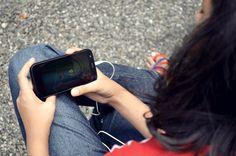girl_watching_cartoon_mobile_free_photo
