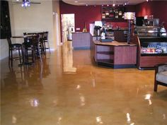 Select Coatings, Inc.  Boynton Beach, FL  The owner of the shop chose an acid staining application, because he wanted a surface that was low-maintenance, durable and beautiful at the same time.