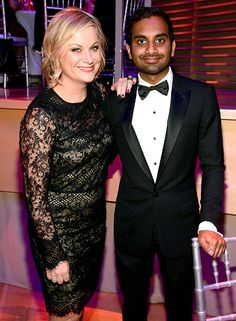 Parks and Recreation co-stars Amy Poehler and Aziz Ansari looked stylish while sharing an embrace