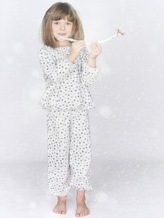 Katrina Tang Photography for Amiki Children Sleepwear AW 15 campaign. Studio shoot with a happy girl in pajamas, smiling, holding a tree branch #katrinatang #tangkatrina