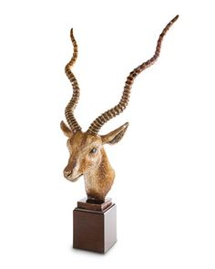 """Jay Strongwater Antelope Head Figurine EUR 6,402.59 is Product Price. Online Inquiries: NMF17_H8PM1 Handcrafted metal figurine on carved wood base. Hand enameled and hand set with 3,000 Swarovski® crystals. 22""""W x 16""""D x 42.25""""T. Made in the USA. About Jay Strongwater: Jay Strongwater's love of the elegant but vividly bejeweled objet—whether it's meant to rest on a tabletop or the graceful curve of a woman's neck—has led him on a journey through the worlds of fashion and home furnishings. He…"""