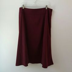 Laura Scott Wine Moleskin Gored Skirt Laura Scott Wine Moleskin Gored Skirt.  Soft A line shape.  Fabric is 97 % polyester and 3% spandex,  but has a suede like feel and look.  Side zipper.  Waist measures 19 inches,  29 inches long. Size 18. Laura Scott Skirts