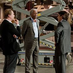 Morgan Freeman, Christian Bale and Christopher Nolan in The Dark Knight Rises
