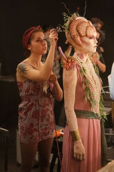 Dina lays the final touches on her goddess.