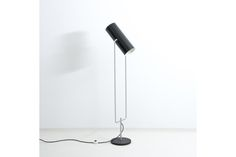 Raak tube floor lamp model D2300, made circa 1960.  Striking rare floor lamp with double lit adjustable tube shade. The lamp has a fantastic shape and is functional too.  The design is attributed to the Raak design team, consisting of among others Nanny Still, Nan Platvoet, Frank Ligtelijn, Nico Kooy, Tapio Wirkkala, Jan Jaspers Fayer, Ger Vos and Ru Melchers.