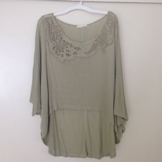 Poncho top, flowy and sweet  Cool pale green, like a light sage color! High low style with an awesome floral lace design along the collar. Lush Tops