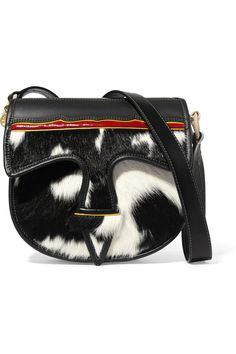 TORY BURCH Cow-print calf hair and leather shoulder bag £320.62 http://www.theoutnet.com/products/689949