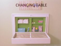 Take a hint from those nasty changing tables in public restrooms and make your own! I like this one much better.   Instructions at http://www.diynetwork.com/home_improvement/13-clever-space-saving-solutions-and-storage-ideas/pictures/index.html