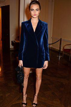 Cara Delevingne with a blue velvet jacket dress.