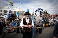 Portrait of a man dressed for Oktoberfest outside the Hofbrau Tent in Munich, Germany, with horses pulling a beer cart © John Bragg Photography Fine Art Photo, Photo Art, Europe Photos, Munich Germany, Draft Horses, Men Dress, Tent, The Outsiders, Fair Grounds