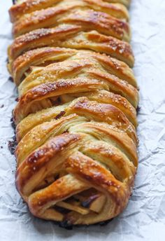 This easy Apple Strudel is filled with cinnamon, brown sugar, raisins and more! It's a crispy, flaky pastry that's easy to make and downright delicious. #applestrudel #applestrudelrecipe #strudelrecipe #strudel #bakedapples #bakedapplesrecipe #appledessert #applerecipe Strudel Recipes, Puff Pastry Recipes, Apple Pie Recipes, Sweet Recipes, Apple Strudel Puff Pastry, Pastries Recipes, German Apple Strudel Recipe, Brunch Recipes, Breakfast Recipes