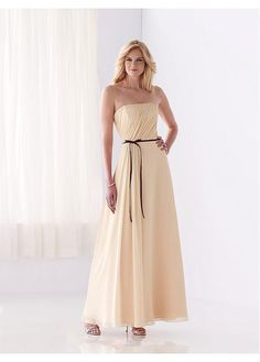 The dress is made of chiffon and poly satin,featuring strapless necklace.The ruffled bodice falls into a floor-length skirt.The sash fabric is satin.