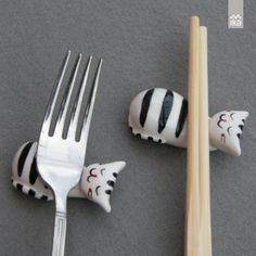 Ceramic Kittens - Tableware Holders made from a white clay, hand painted and glazed with the translucent glaze.