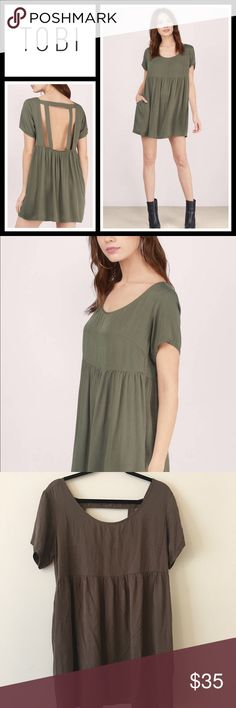 Tobi Solid love olive day dress NWT New with tags, size medium - Designed by Tobi. The Solid Love Babydoll Dress features a back cut out with bar strap for stability. Relaxed fit for a comfortable body. Dress it up with platform heels or down with flats. Tobi Dresses