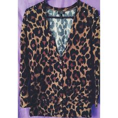 Cheetah Print Studded Shoulder Cardigan! Cheetah Print cardigan! The shoulders are studded. In the last picture shows the flaw, one stud is missing but you can barely tell. And on-you can't see it all! That is the only flaw. This cardigan is like brand new! Nollie Sweaters Cardigans