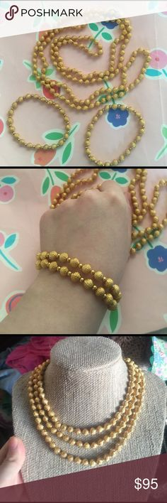 18kt Gold Plated Necklace & Bracelet Set 18kt plated gold. Necklace can be worn long or wrapped around neck. 2 matching bracelets are stretchy! This set has a very nice quality weight to it. Like new condition. A stunning set! Jewelry Necklaces