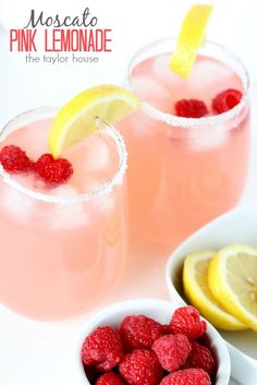 Moscato Pink Lemonade is the perfect cocktail recipe for enjoying the spring weather with your friends! Dust the rims of your glasses with sugar and garnish with raspberries and lemon for extra flavor.