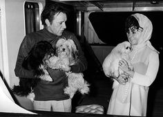 Married actors Richard Burton and Elizabeth Taylor hold the family dogs aboard the boat 'Beatriz of Bolivia', Tower Pier, London, England, February 17, 1968.