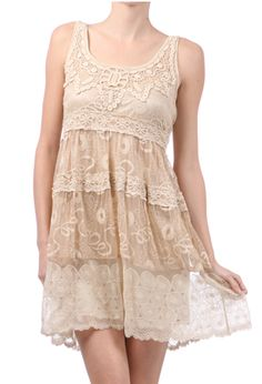 A Cowgirl Beige Vintage Lace Dress...way too short for me, but I could do it as a blouse over a wonderful swirly skirt!