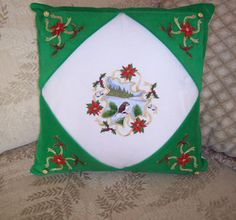 Pillow with Christmas nature scene machine embroidery design.