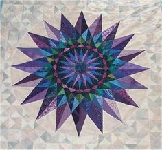 Mariner's Jewel (Center star) by Kristi L. Parker. I adore Mariner's Compass patterns and this one is marvelous. Of course, it being made with some of my favorite colors sure doesn't hurt!