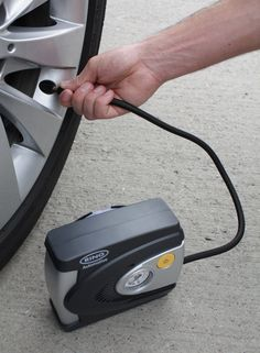Inflating a tyre using the Ring Automotive RAC610 12V Analogue Compressor http://tyreinflatorguide.com/ring-automotive-rac610-review/