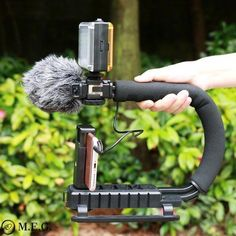 The U-Grip features a shock-proof rubber handle that alleviates stress by offering a comfortable, secure grip. U-Grip Video Action Stabilizing Handle Grip Rig Office Gadgets, Cool Tech Gadgets, Gadgets And Gizmos, Latest Gadgets, Photography Tools, Camera Nikon, Rigs, Cool Toys, Filmmaking