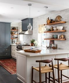 White Kitchen Slate Floors Dark Cabinets via House and Home