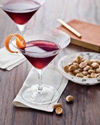 The Savoy Daisy  2 ounces ruby port 1/4 ounce Bacardi 8-year aged rum 1 ounce Diplomatico Reserva Exclusiva rum 2 tablespoons freshly squeezed lemon juice 1/2 teaspoon muscovado sugar 1/2 tablespoon grenadine 1 orange twist