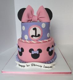 This Minnie Mouse 1st birthday cake was an Icing Smiles cake for 1 year old London!  |   https://www.facebook.com/KarasBakeShoppe