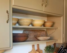 Love the shelf/cabinet combination and of course the yellowware bowls combined with the wood bowls
