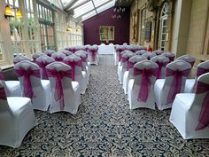 Burgundy blue sashes on white chair covers at The Manor Hotel Yeovil